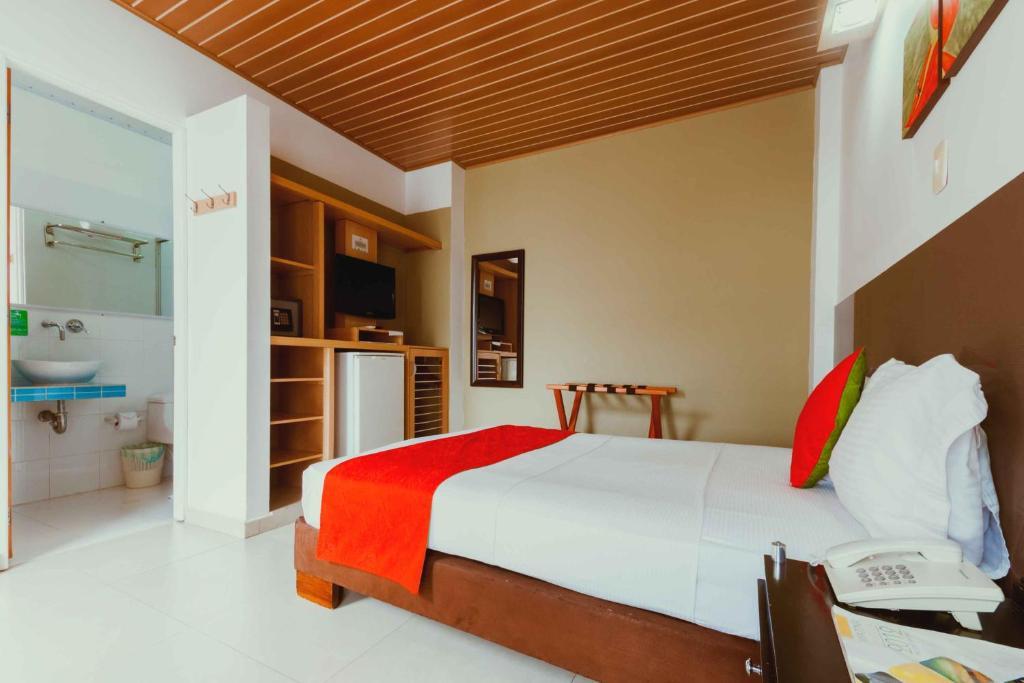 Cama o camas de una habitación en Waira Suites