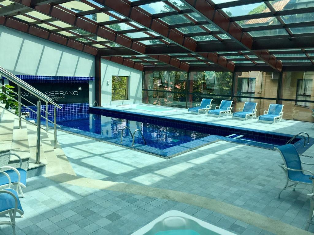 The swimming pool at or close to Flat Prodigy Serrano Hotel