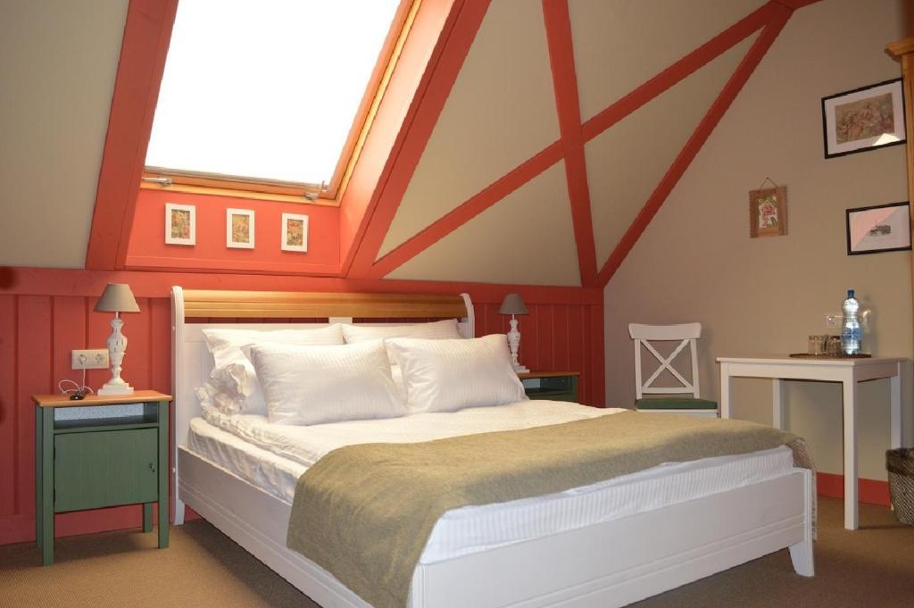 Кровать или кровати в номере Конный клуб Вента Арена