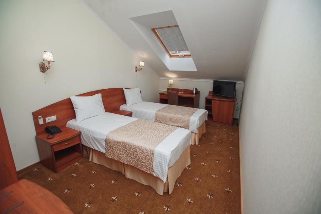 Кровать или кровати в номере Отель Вилладжио