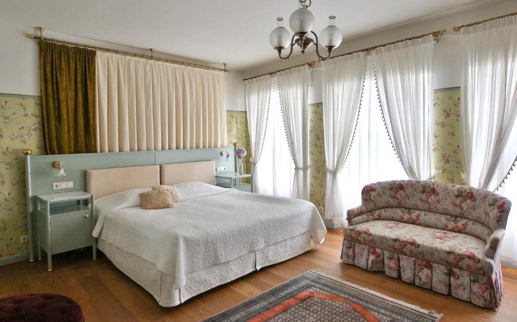 Voodi või voodid majutusasutuse Antonius Hotel toas