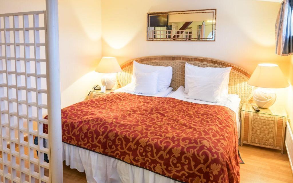 Posteľ alebo postele v izbe v ubytovaní Hotel Seaport