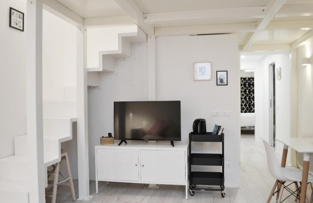 A television and/or entertainment center at Cozy Design Apartment