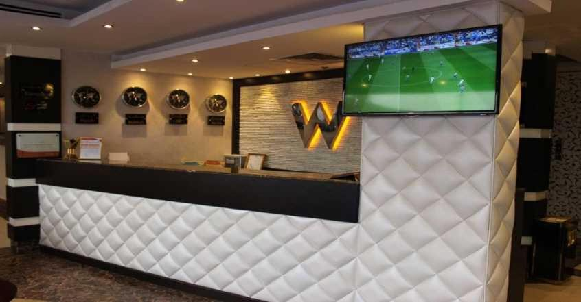 The lobby or reception area at Wharf Suites