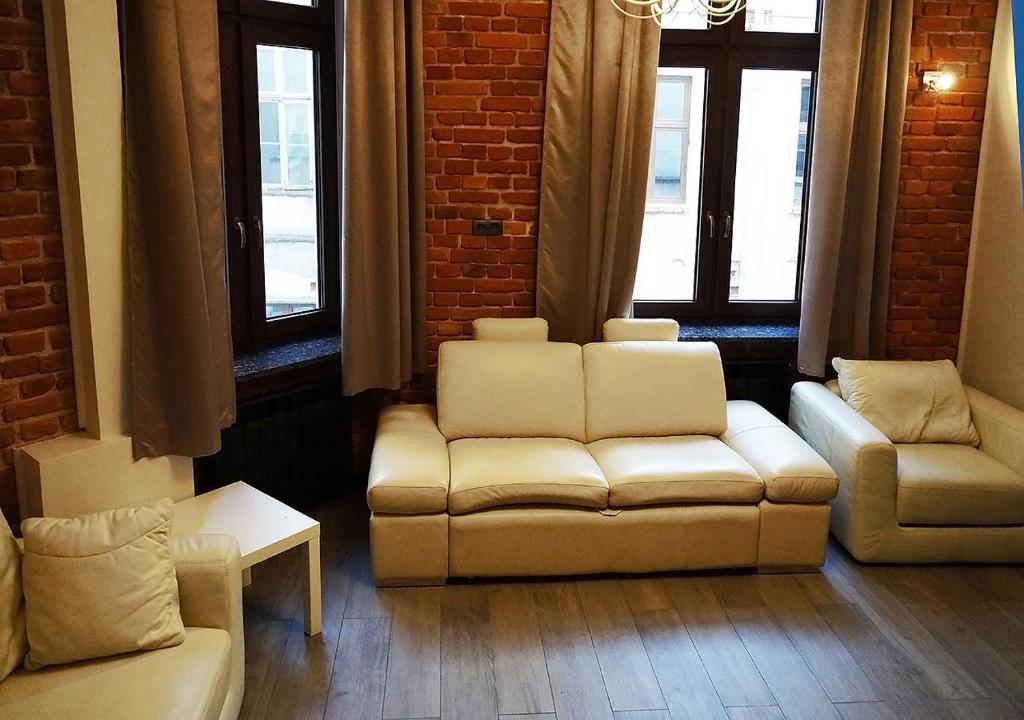 A seating area at Aparthotel Łódź 55 & Apartments
