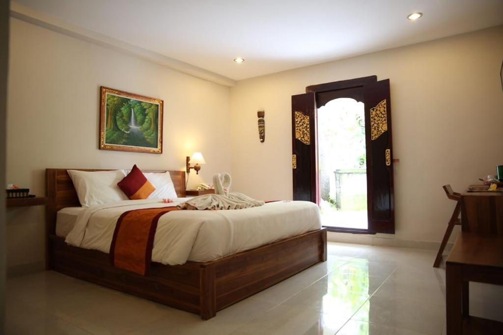 Llit o llits en una habitació de AS Resort