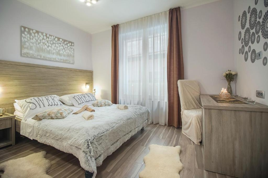 A bed or beds in a room at Holiday Center Ivona