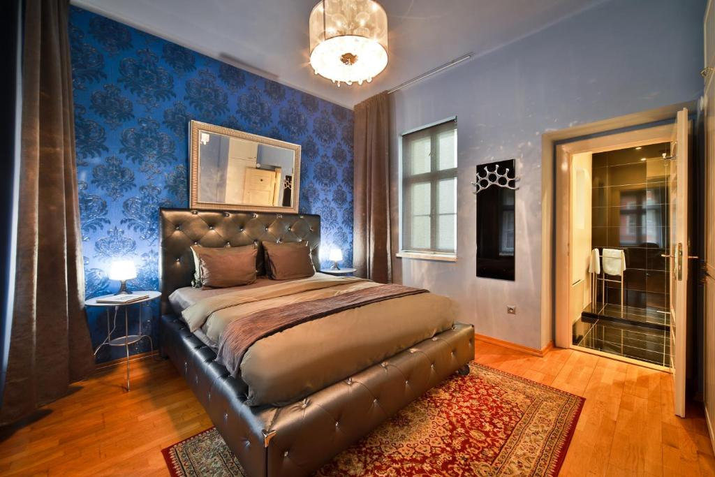 A bed or beds in a room at Prague Castle Questenberk Apartments