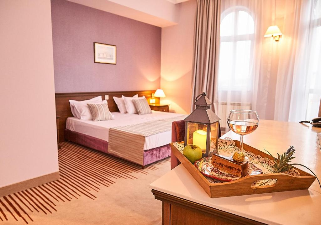 A bed or beds in a room at Hotel Lion Sofia