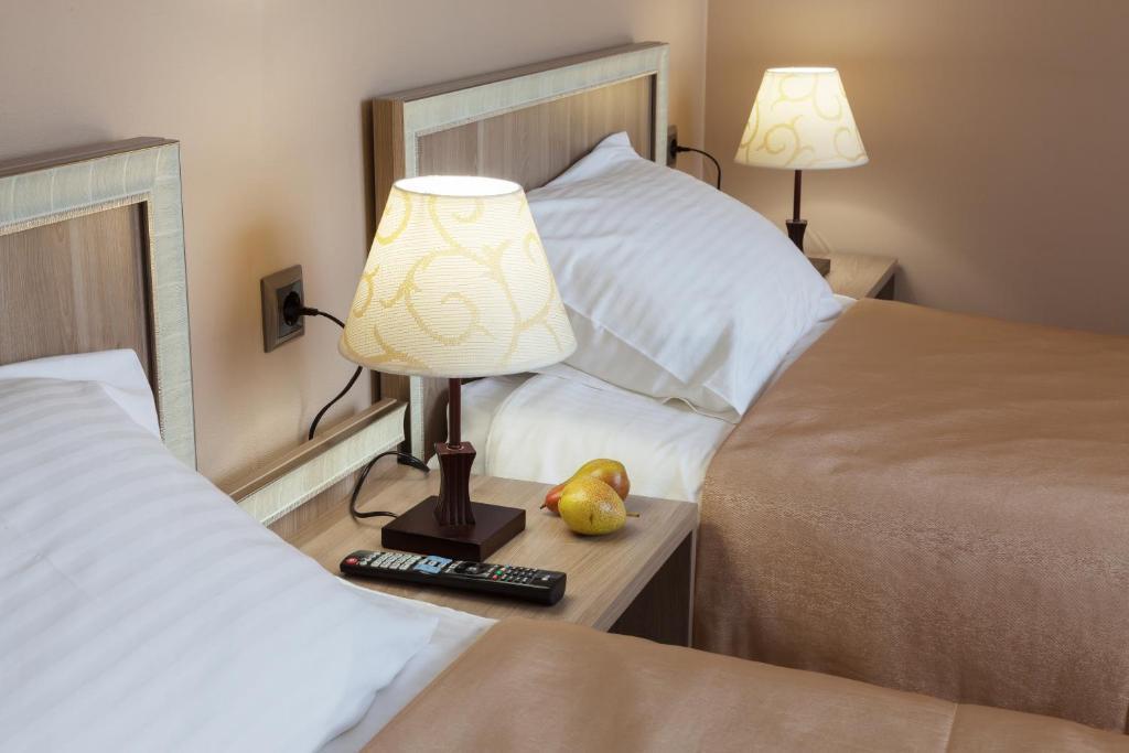 Кровать или кровати в номере Отель Арбат