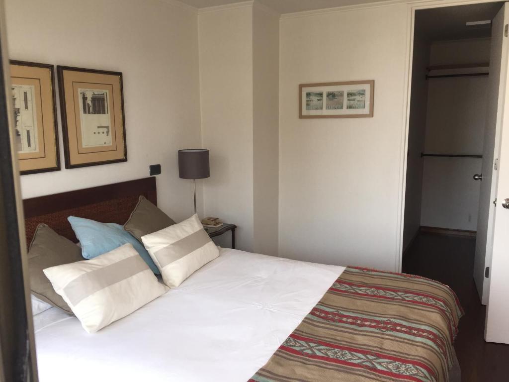 Cama o camas de una habitación en Bellavista Forestal Apartment