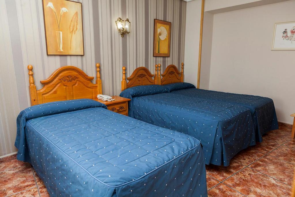 Cama o camas de una habitación en Hotel Guadalquivir