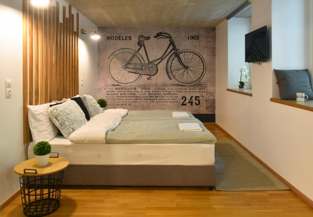Ein Bett oder Betten in einem Zimmer der Unterkunft Walk Inn Váci 78