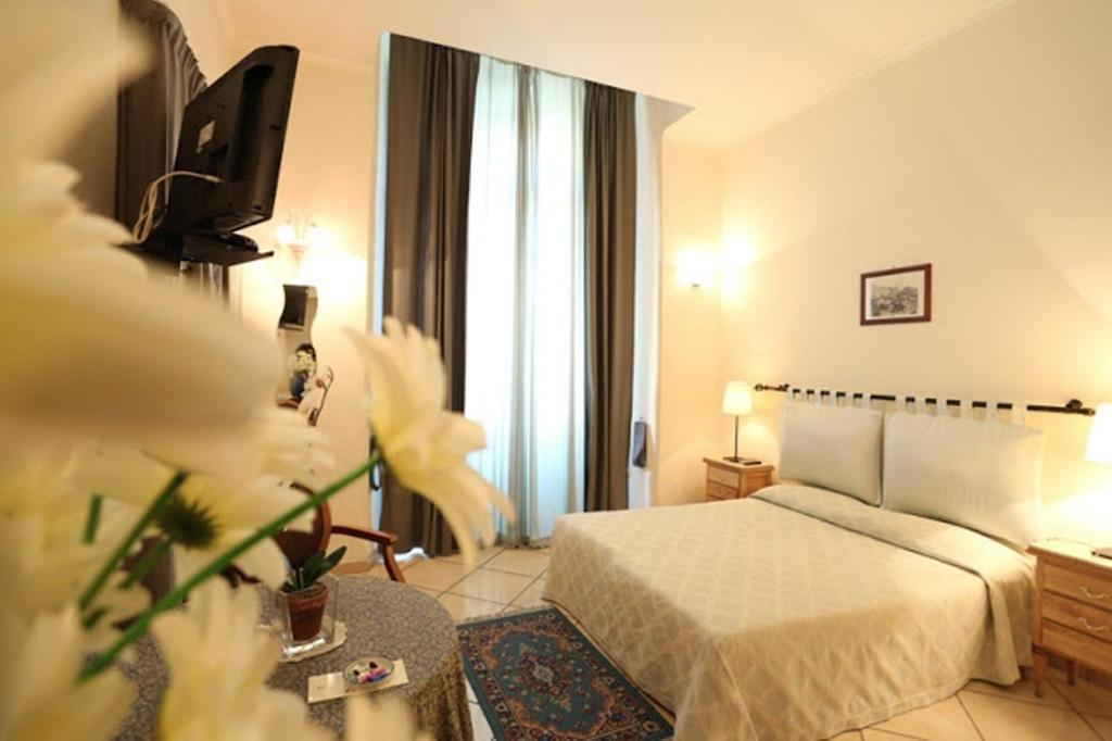 A bed or beds in a room at Bovio Suite