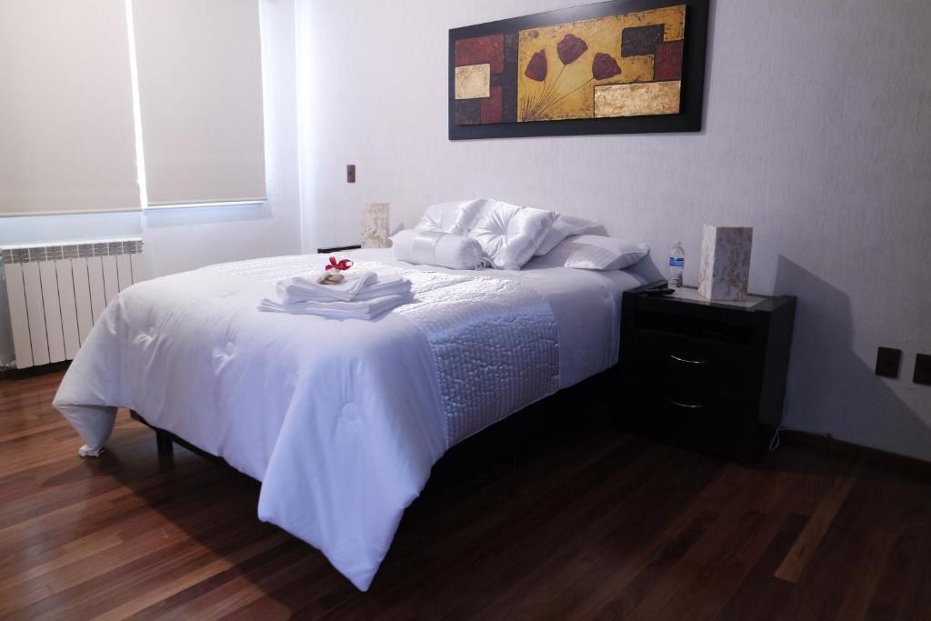 A bed or beds in a room at Habitación acogedora c/ excelentes servicios