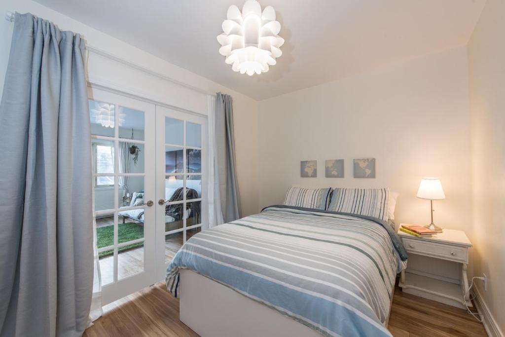 A bed or beds in a room at Gite du Survenant