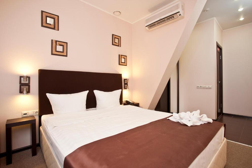 Кровать или кровати в номере Отель Инсайд Транзит