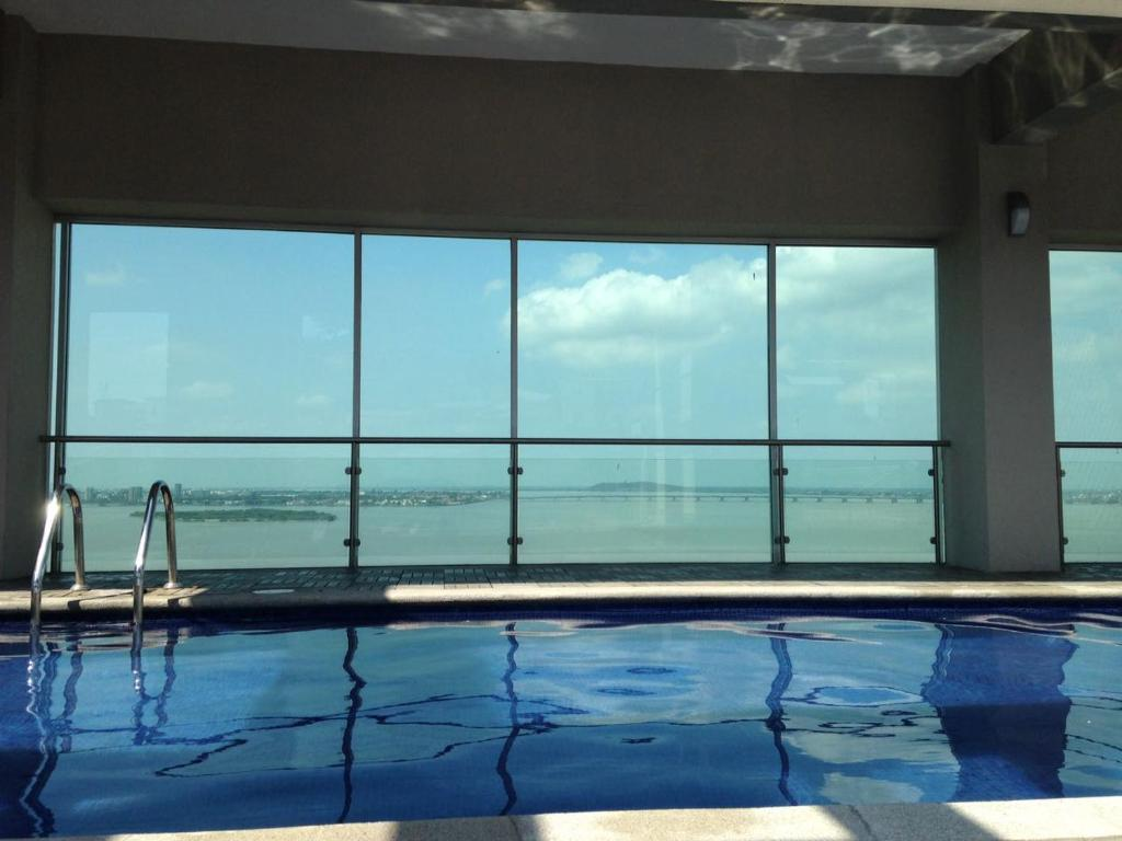The swimming pool at or near River View suites Puerto Santa Ana