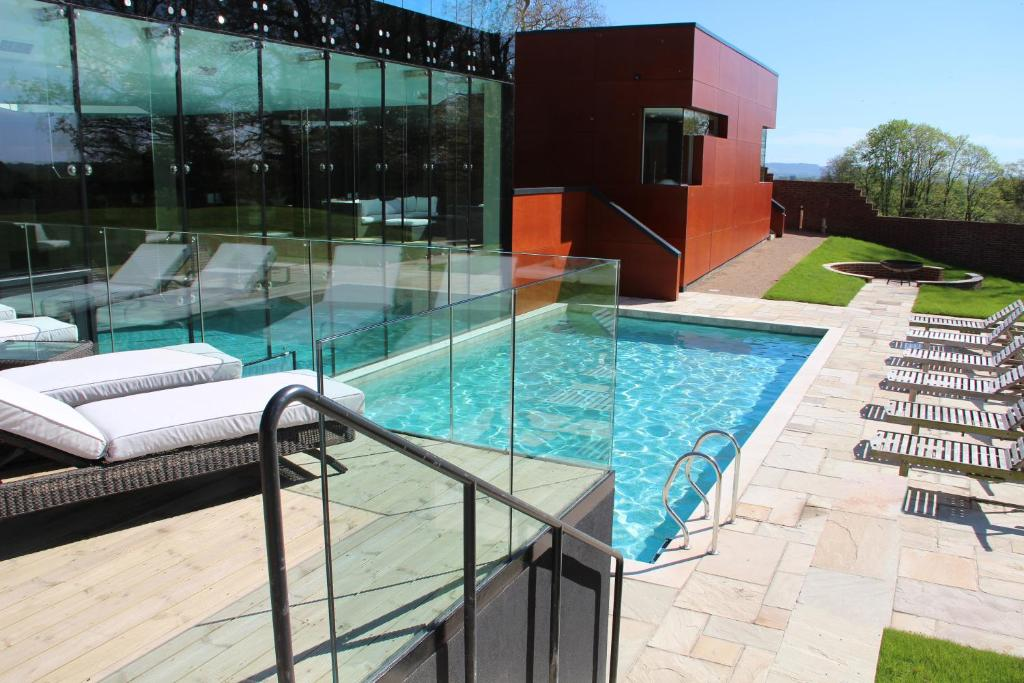 The swimming pool at or near Ockenden Manor Hotel & Spa