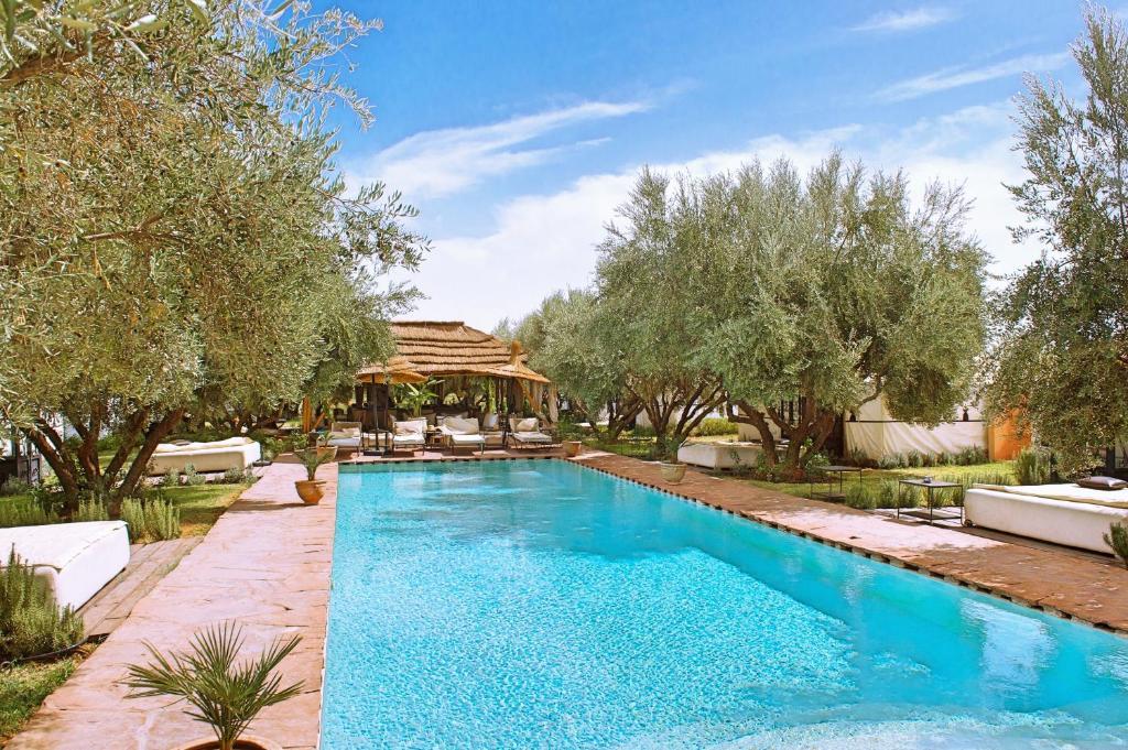 The swimming pool at or near La Ferme El Dar