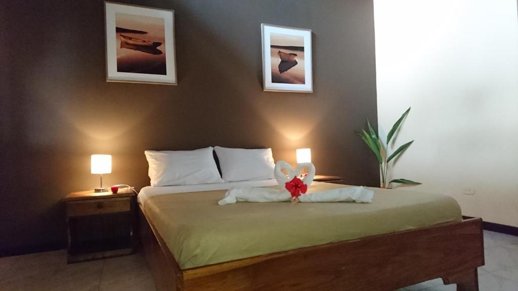 A bed or beds in a room at Morpheus Exotica Lodge