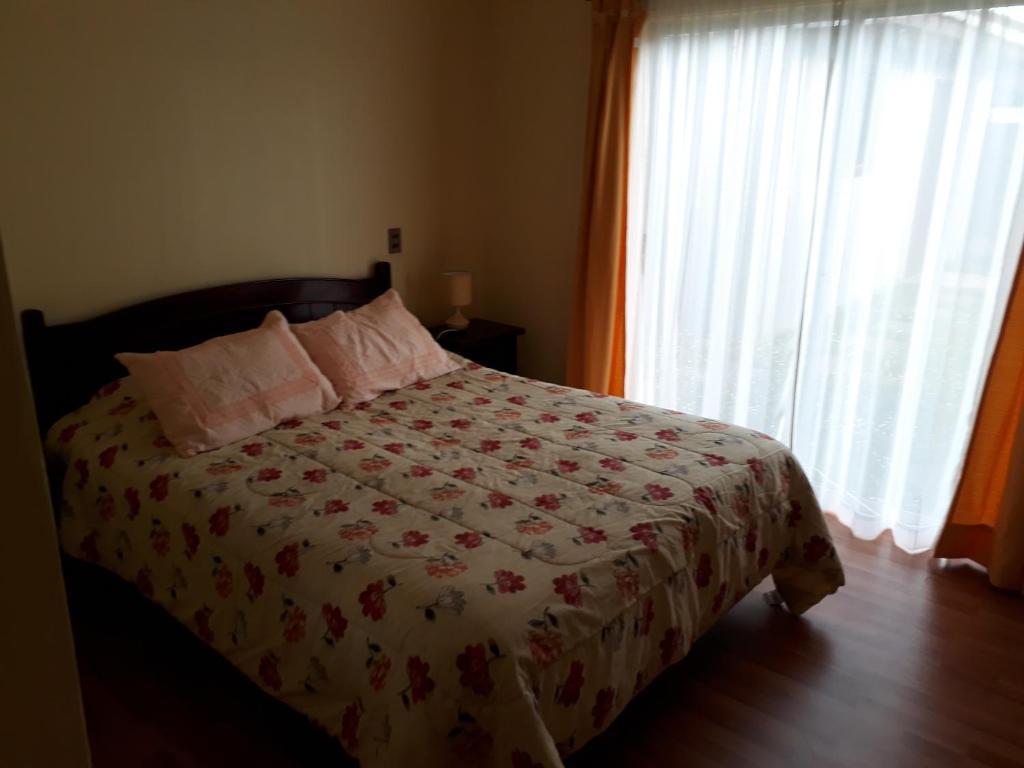 Cama o camas de una habitación en Casa Jardines del Mar, Puerto Montt