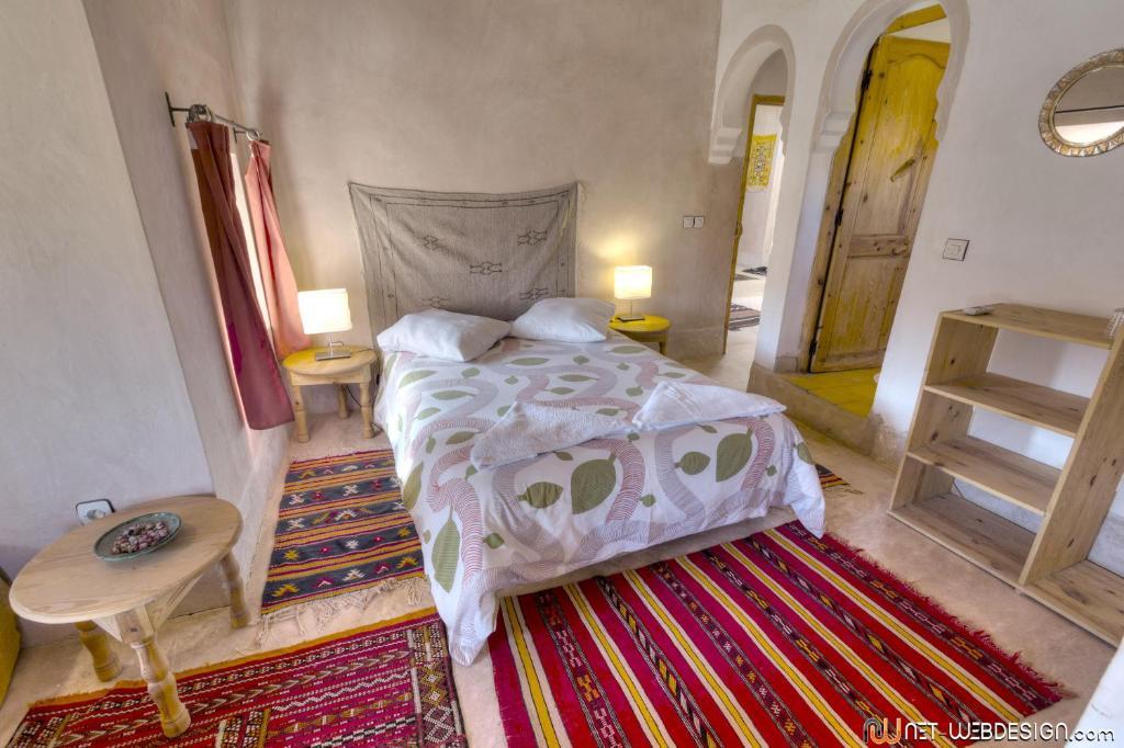 Cama o camas de una habitación en Kasbah Agoulzi