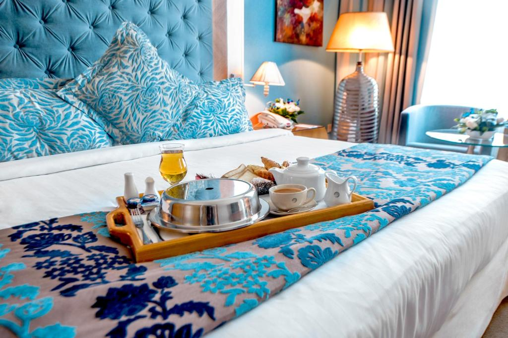 A bed or beds in a room at Marina Byblos Hotel