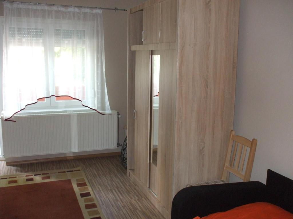 A bed or beds in a room at Anikó Apartman
