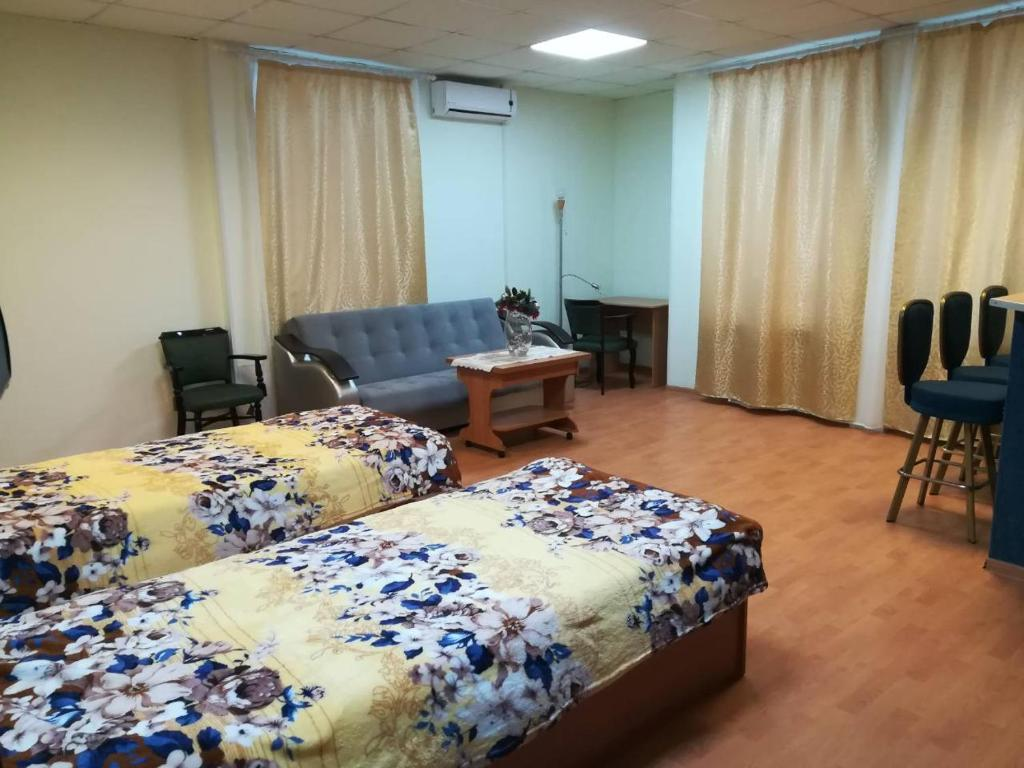 A bed or beds in a room at Комплекс Отдыха Беликово