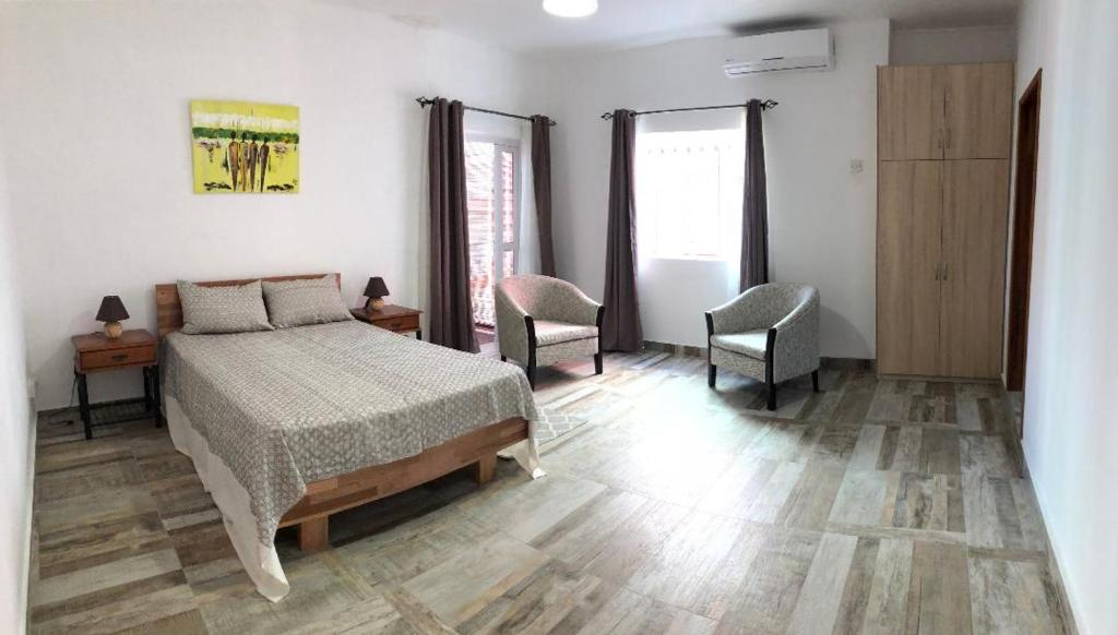 A bed or beds in a room at Kays Residence
