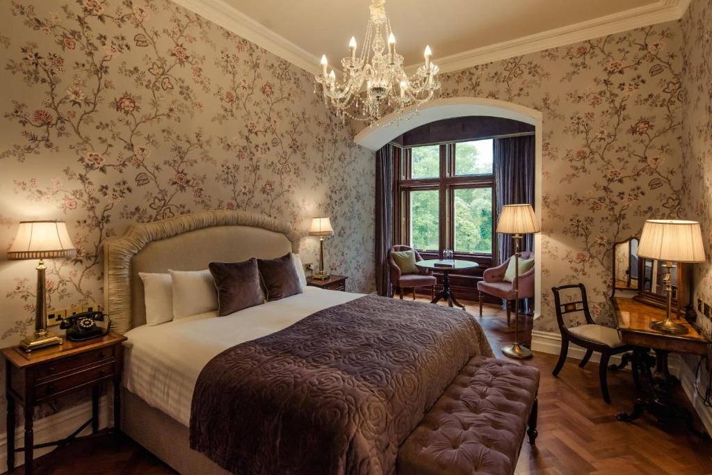 A bed or beds in a room at Cahernane House Hotel