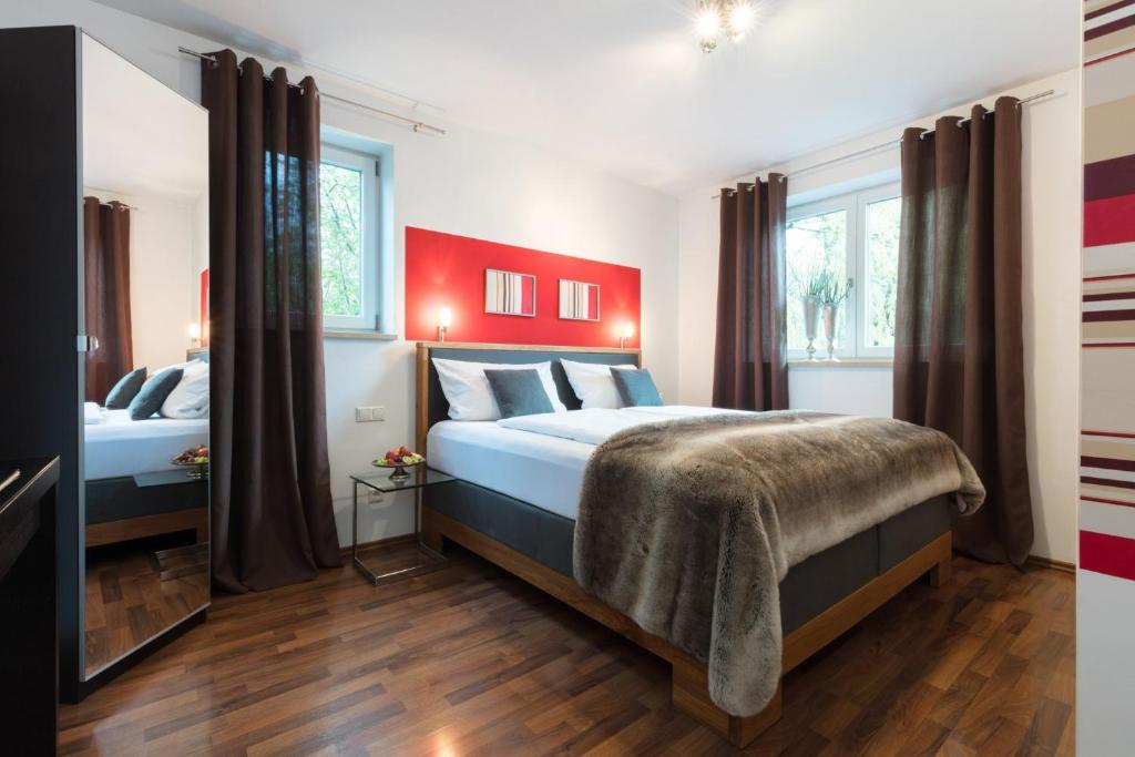 Ein Bett oder Betten in einem Zimmer der Unterkunft Hotel Villa Rosa