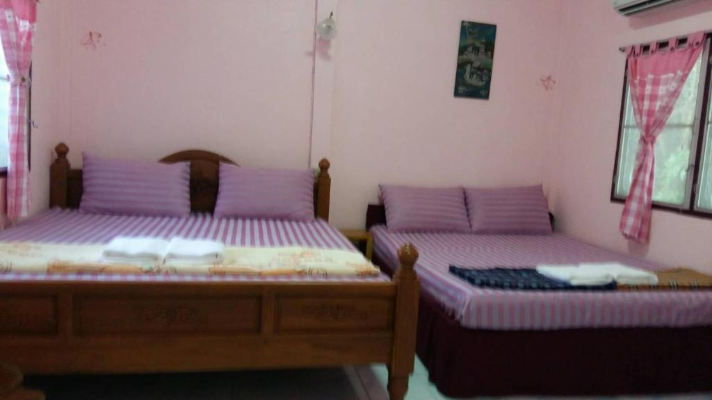 A bed or beds in a room at Sab Ananta Resort
