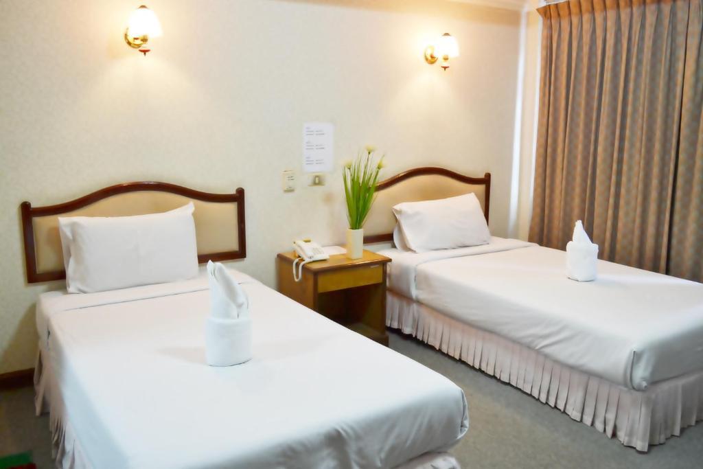 Ein Bett oder Betten in einem Zimmer der Unterkunft Anou Paradise Hotel