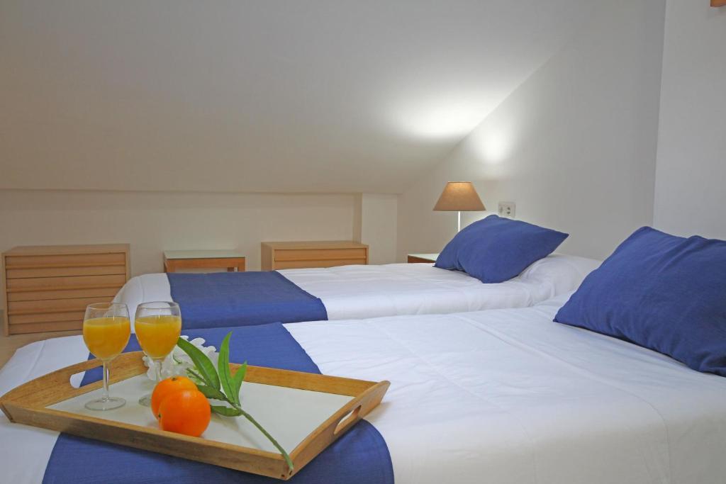 Letto o letti in una camera di Edificio Cervantes GrupalMalaga