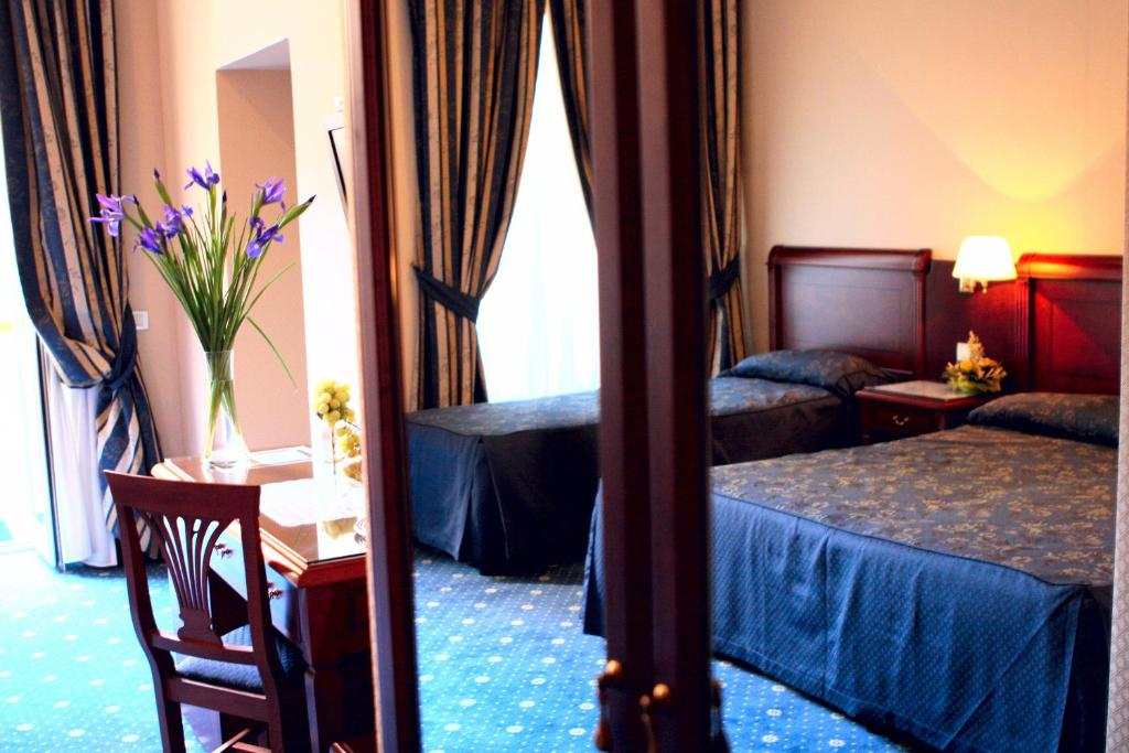 Letto o letti in una camera di Hotel Artorius