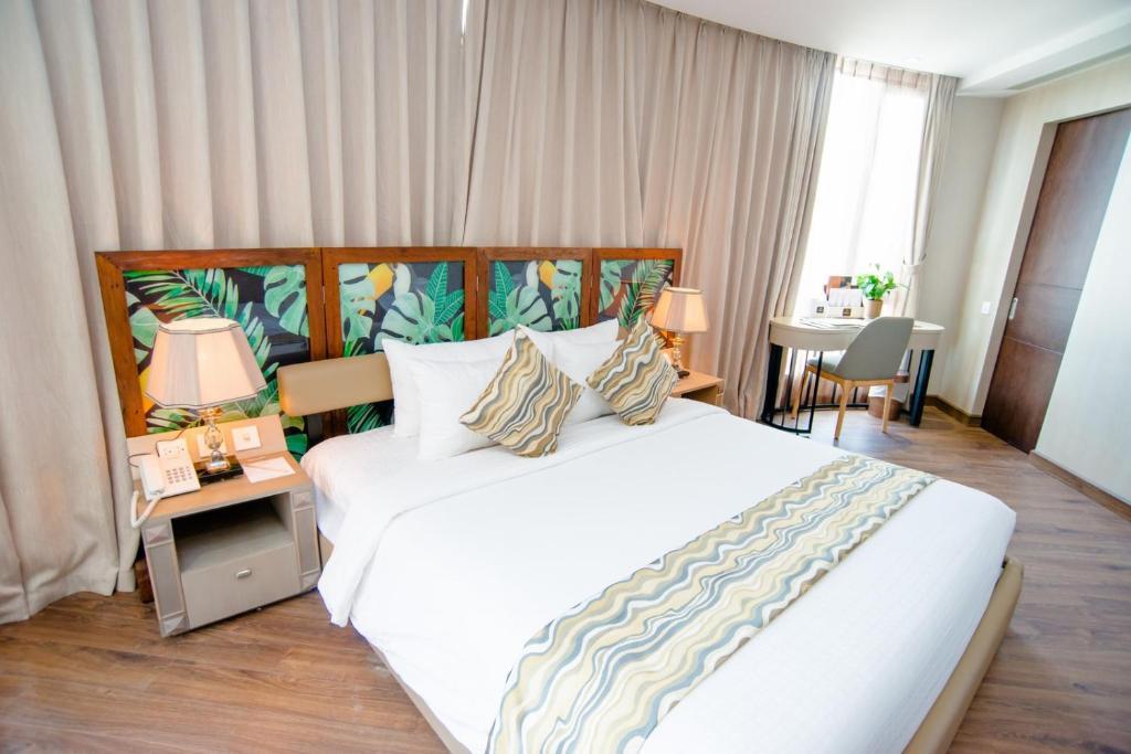 西貢木瓜中央酒店房間的床