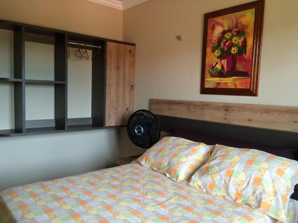 A bed or beds in a room at Guaramiranga Apart Monte Verde