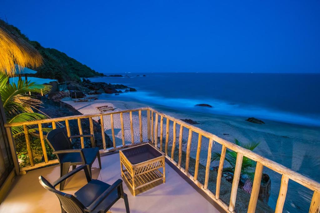 A balcony or terrace at Dwarka Eco Beach Resort