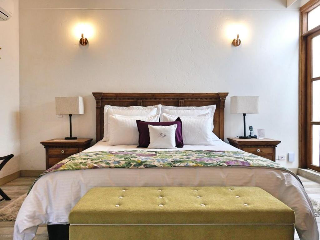 A bed or beds in a room at Casa Passiflora Hotel Boutique