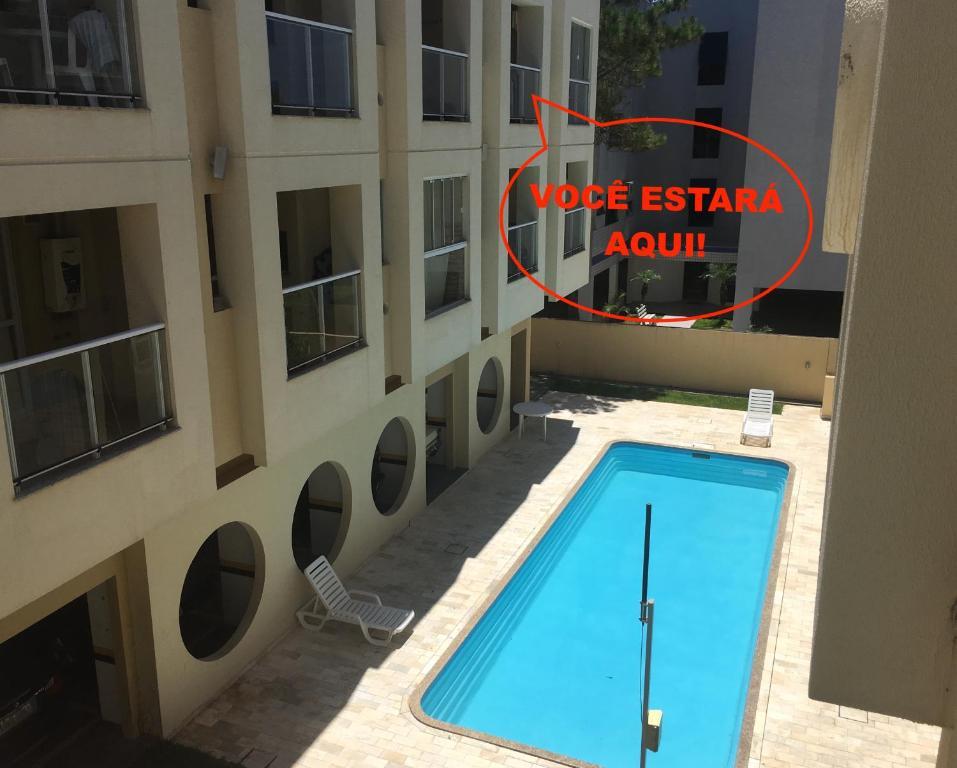 Vista de la piscina de Apartamento na Brava o alrededores