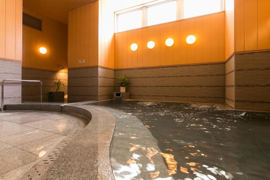 The swimming pool at or close to Nishitetsu Inn Kokura