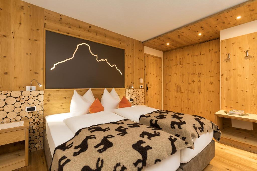 เตียงในห้องที่ Hotel Bel Sit