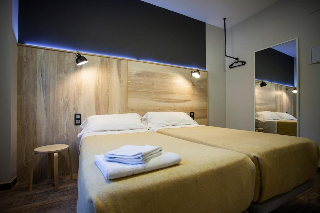 A bed or beds in a room at CC Atocha