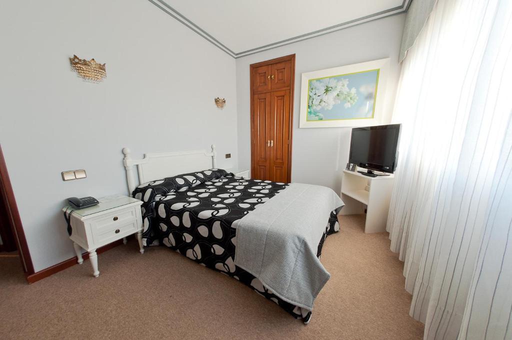 Cama o camas de una habitación en Hotel Don Pepe