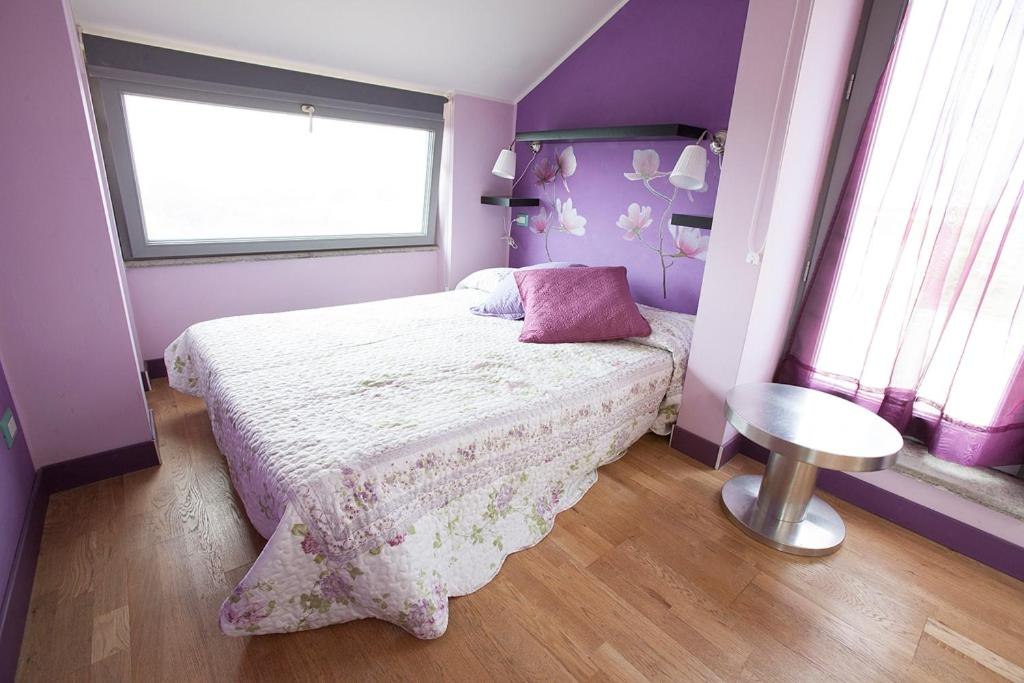 A bed or beds in a room at Axia Terme B&B