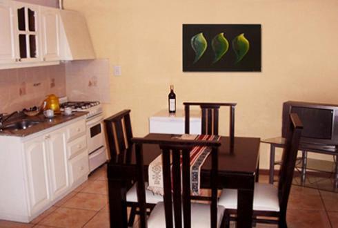 Una cocina o kitchenette en Apart Hotel Mendoza