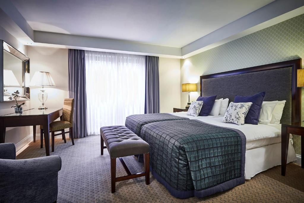 A bed or beds in a room at Wrightington Hotel & Health Club