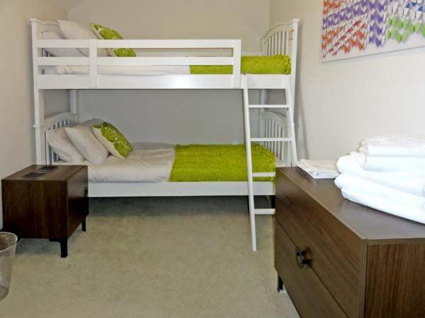 A bunk bed or bunk beds in a room at Brynich Villa